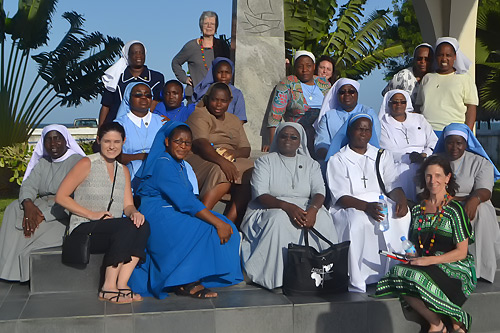 ASEC board members Brighid Blake (standing, top) and Terri Peters (bottom, right) pose for a group photo with ASEC staff.