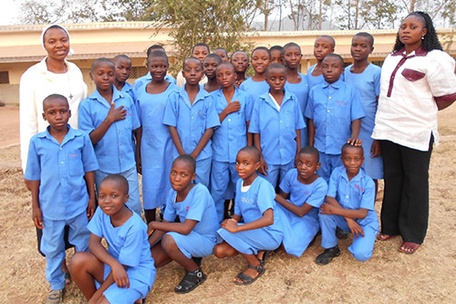Sr. Yvette Sam (left) with a handful of Students of St. Marys' Catholic Comprehensive College, Ndop.