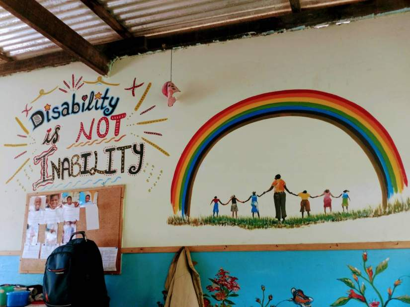A colorful mural reading