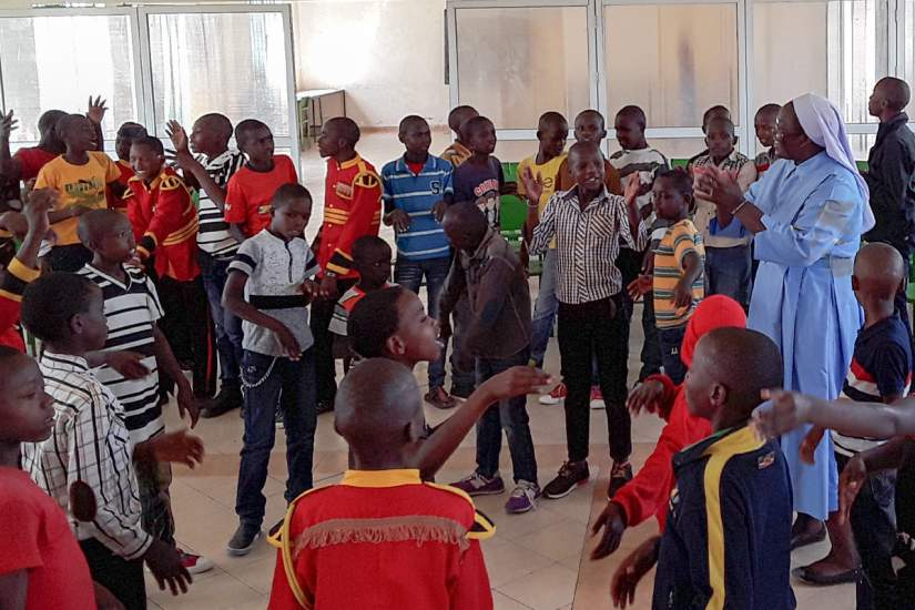 Sr. Draru with street boys at Kwetu Home of Peace, a rehab center in Nairobi, Kenya where ASEC alumnae serve (Oct., 2018).