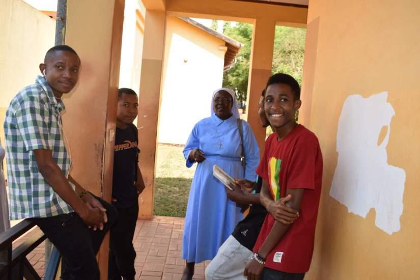 Sr. Draru talks with students of ASEC partner, Jordan University College (JUCO), in Morogoro, Tanzania.