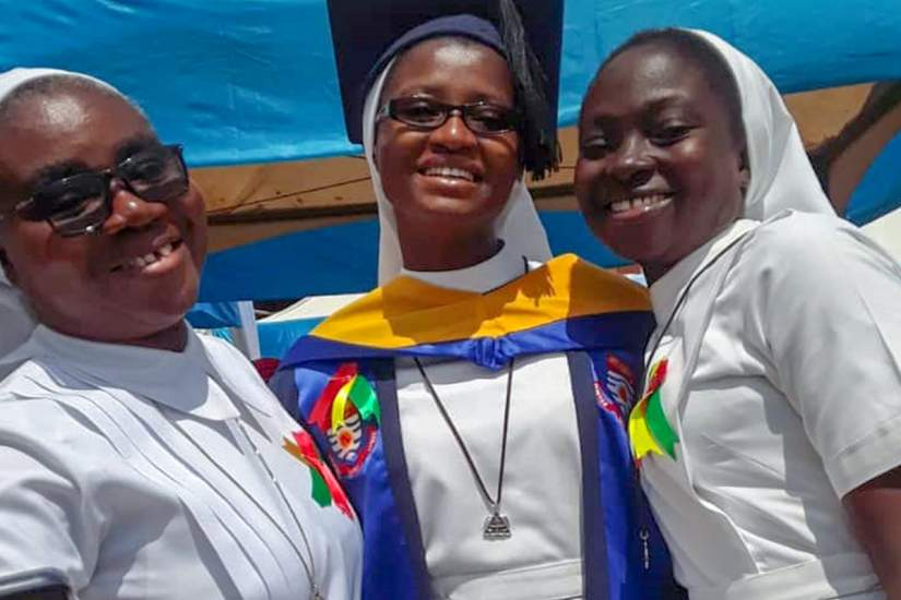 Sr. Philomena Aboagye-Danso, FST (center), received an award as the overall best graduating student at the Catholic University College of Ghana, where she studied education.