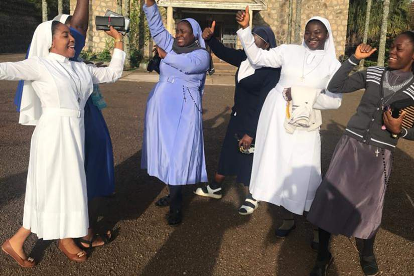 Sisters in Cameroon dancing together when reunited with friends at the HESA Reflective Workshop (2019). 90% of enrolled HESA students participated in 13 HESA reflective learning workshops across 10 countries.