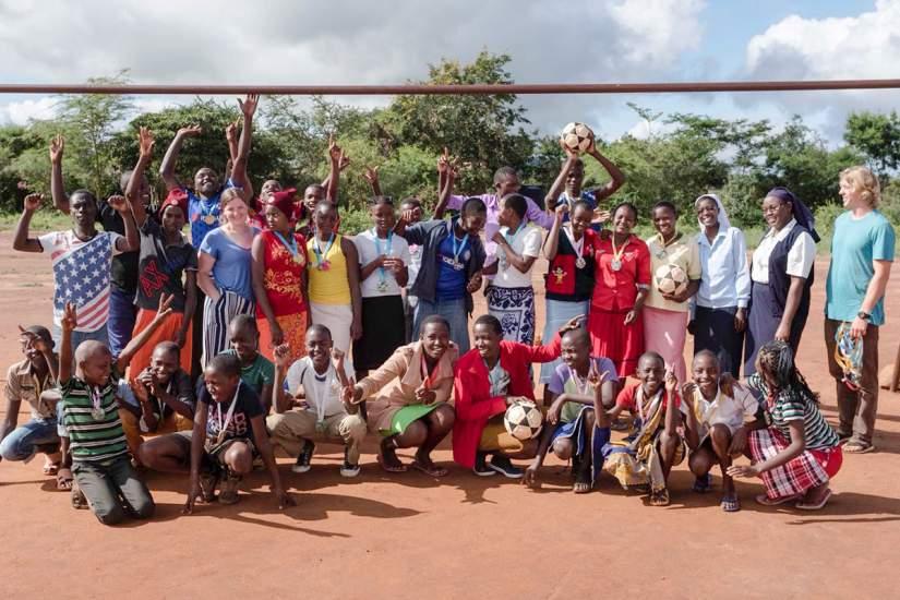 Sr. Faith Kamau and her group of children after playing sports at Nyumbani Village.