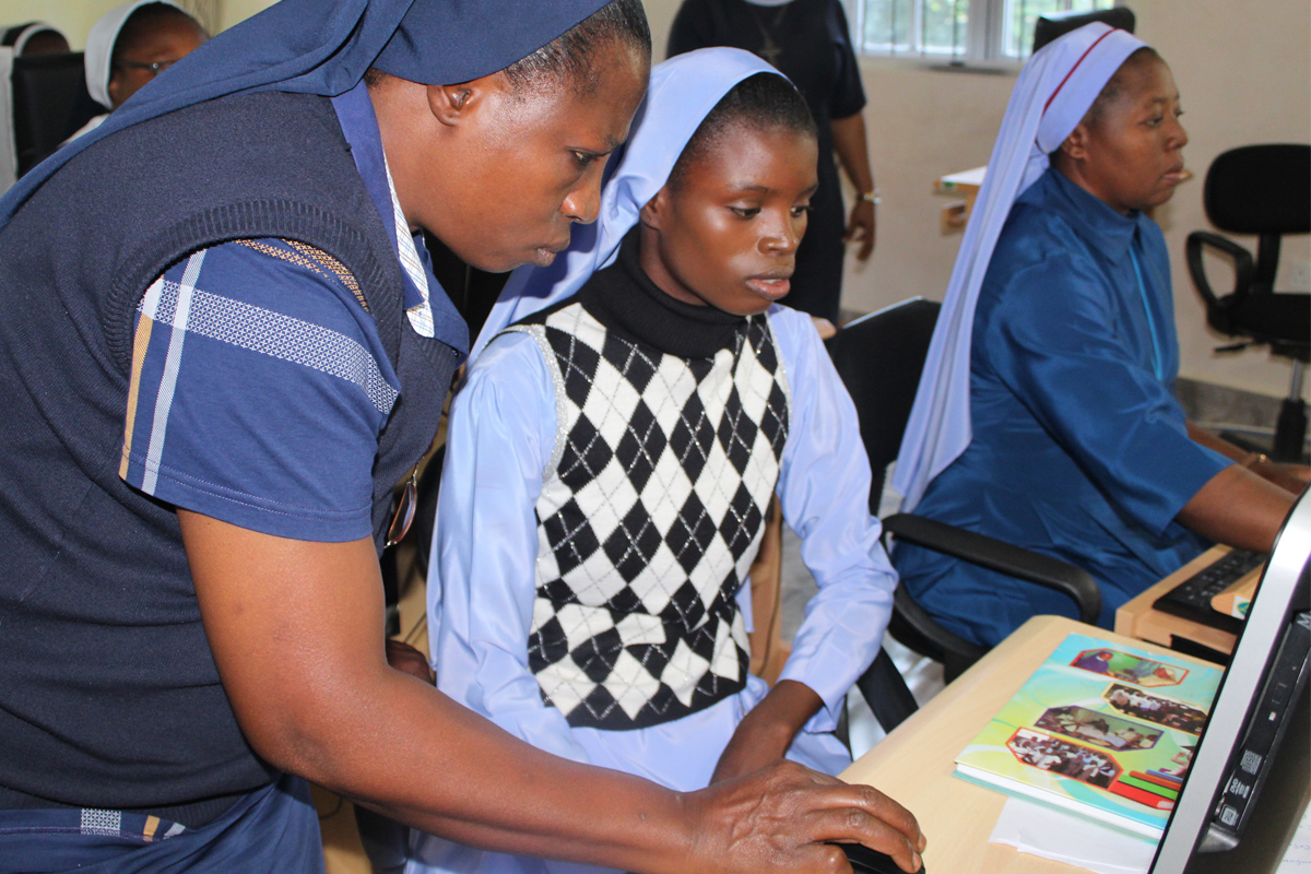 Catholic nuns from Nigeria participate in the SLDI program Basic Technology workshop where they learn computer skills to help them in their ministries.
