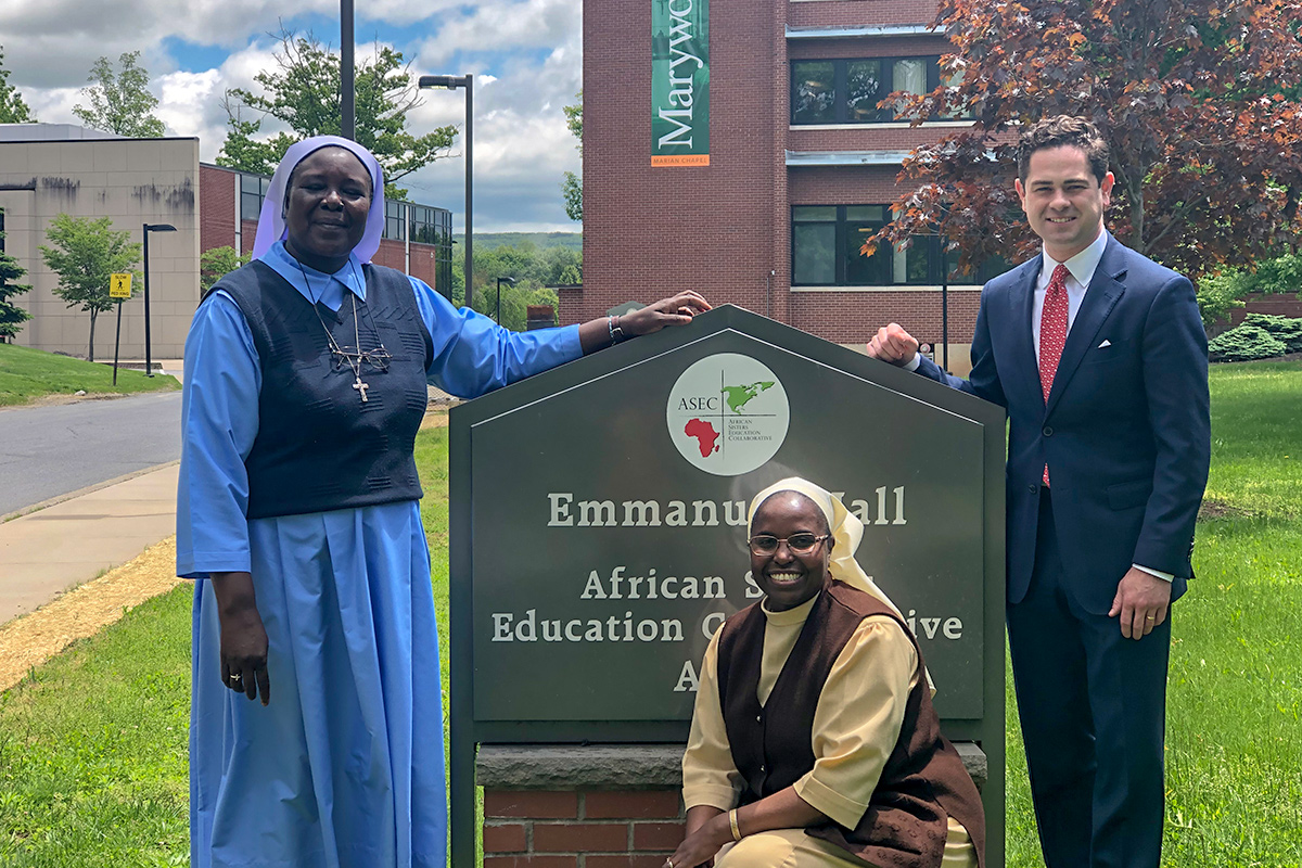 ASEC Executive Director Sr. Draru Mary Cecilia, LSMIG, Ph.D. of Uganda (left) and ASEC Asst. Director of Development Sr. Nancy Kamau, LSOSF, of Kenya (center) pose with Hon. Kyle J Mullins (right) at ASEC's headquarters, located on Marywood University's campus in Scranton, PA