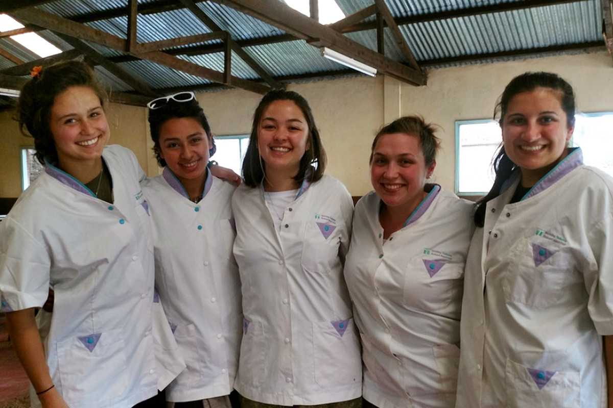 Service Learning students pose for a group photo during their service at St. Martin's Feeding Program.