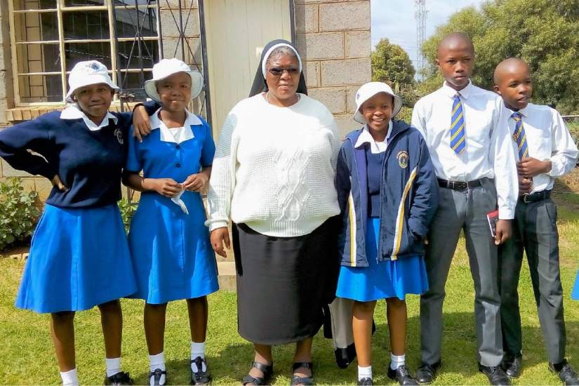 Sr. Augustina (center) with students of Mazenod High School in Maseru, Lesotho.