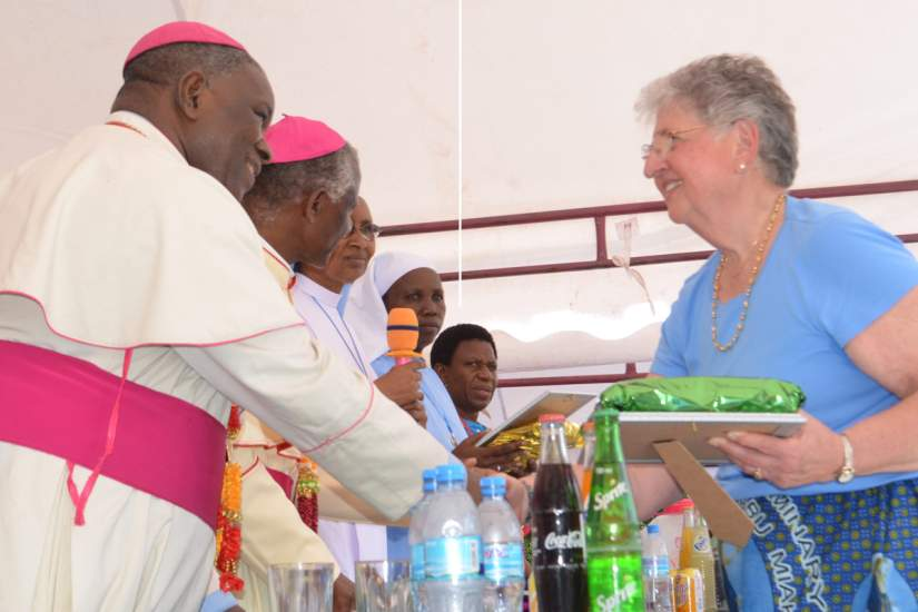 ASEC Board Member Dr. Jane Farr, traveled from the USA to Tanzania to attend Bigwa's Golden Jubilee celebration on ASEC's behalf. Here she is greeted by Bishop Joseph T. Lebulu.