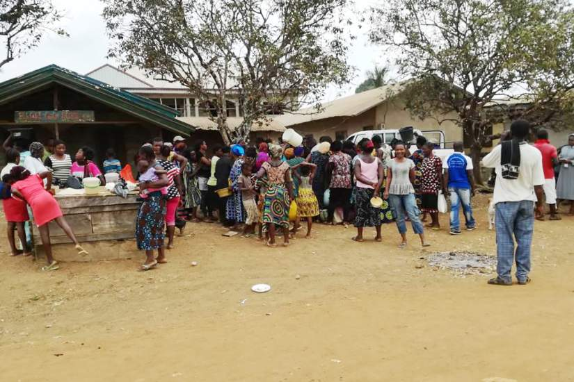 In this displaced village in Cameroon, the struggling villagers collect much-needed supplies from the sisters of the socio-cultural Commission.