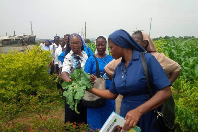 SLDI participants in Nigeria walking through Pastor Usman's