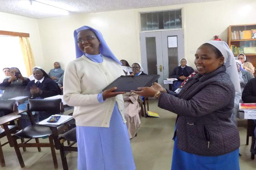 During the Kenya SLDI Administration I Workshop in May 2017, Sr. Adelaide receives her laptop from Sr. Lina, the ASEC Regional Director East & Central Africa.