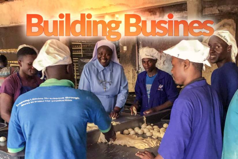Executive Director, Sr. Draru Mary Cecilia, tries her hand at baking bread during a staff site visit to Cabana Sisters' Bread Bakery in Uganda. The Cabana Bakery is run by SLDI and HESA alumna Sr. Maria Teopista Namigga and the Immaculate Heart of Mary Reparatrix (IHMR) Sisters.