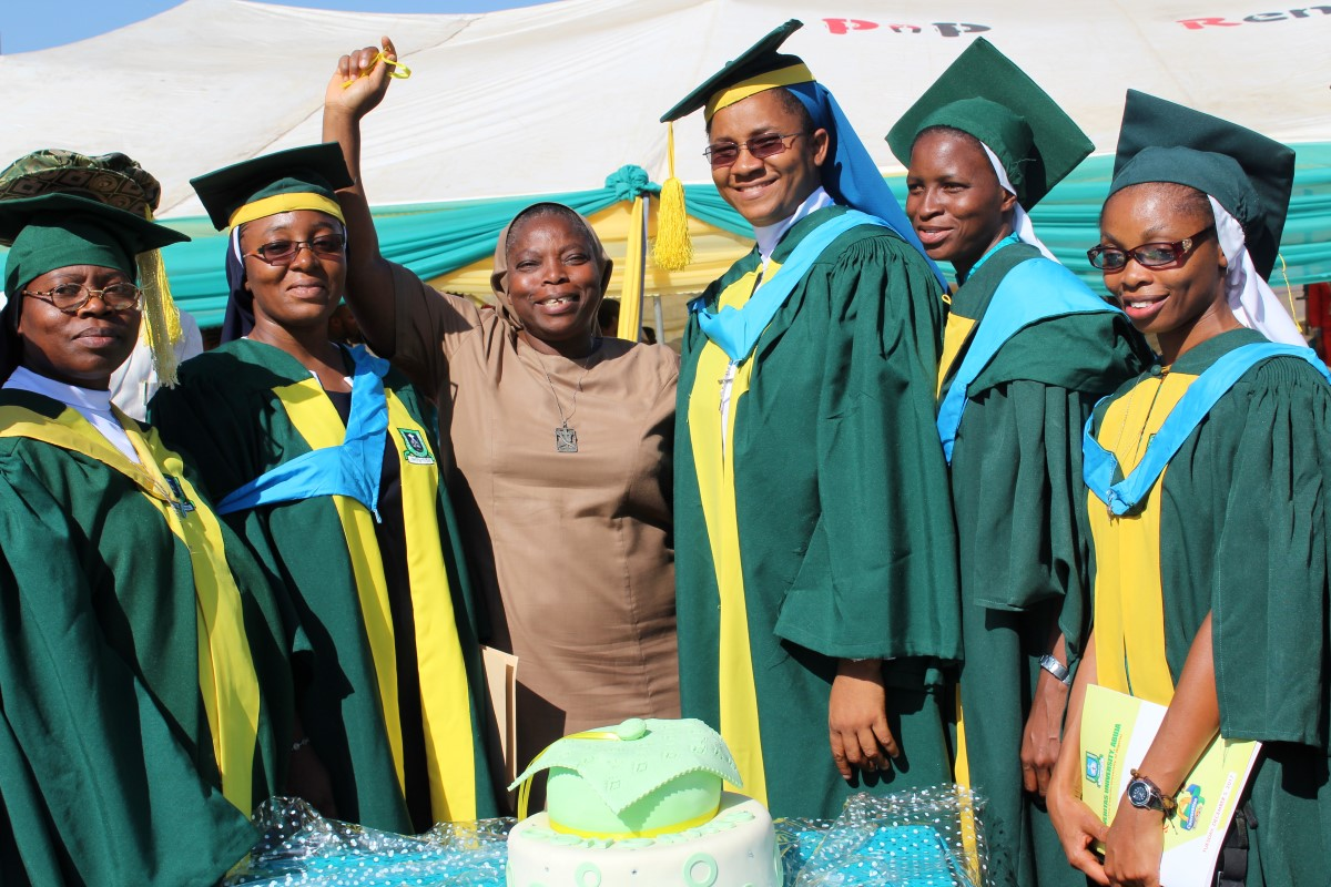 Some of the HESA graduating sisters pose for a photo with Sr. Clementina Obembe, OSF, ASEC Regional Director – West Africa.