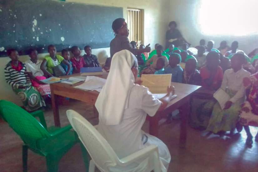Sr Sonia and Agnes in a support group session with HIV positive children.