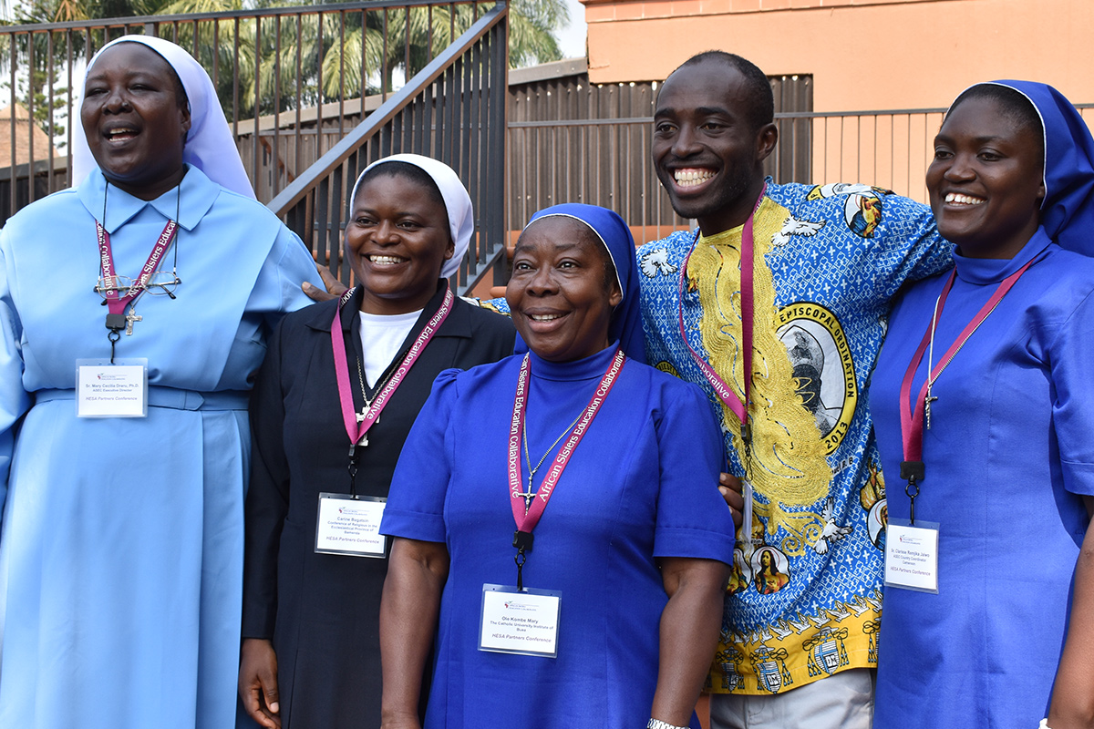 HESA partners from 10 countries traveled to Uganda for the first HESA conference held June 19-23 in Uganda. Here, ASEC Executive Director Sr. Draru Mary Cecilia, LSMIG, Ph.D. (left) joins HESA partners from Cameroon for a photo.