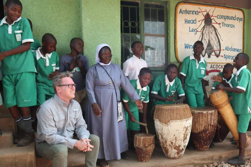 After the conference, ASEC staff and partners visited students and ASEC alumnae at Kikyusa Primary & Secondary schools in Kikyusa, Uganda. In this photo Jim Sullivan, Dean of Continuing and Professional Studies at Marywood University in Scranton, Pennsylvania, US enjoys a performance by the students.