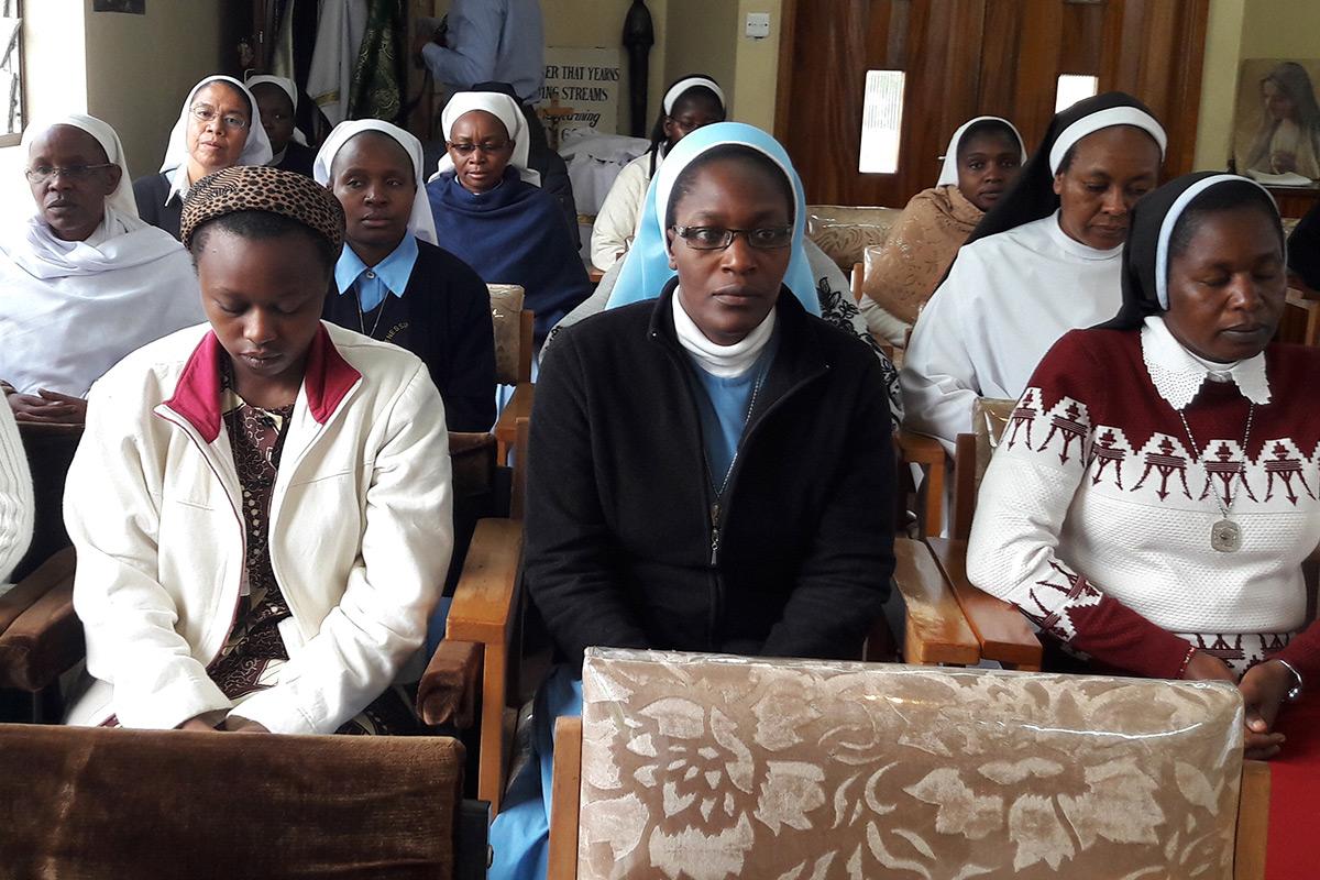 SLDI workshop participants in Kenya meditate together before mass.