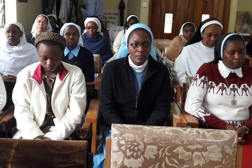 SLDI workshop participants in Kenya meditate together before mass.