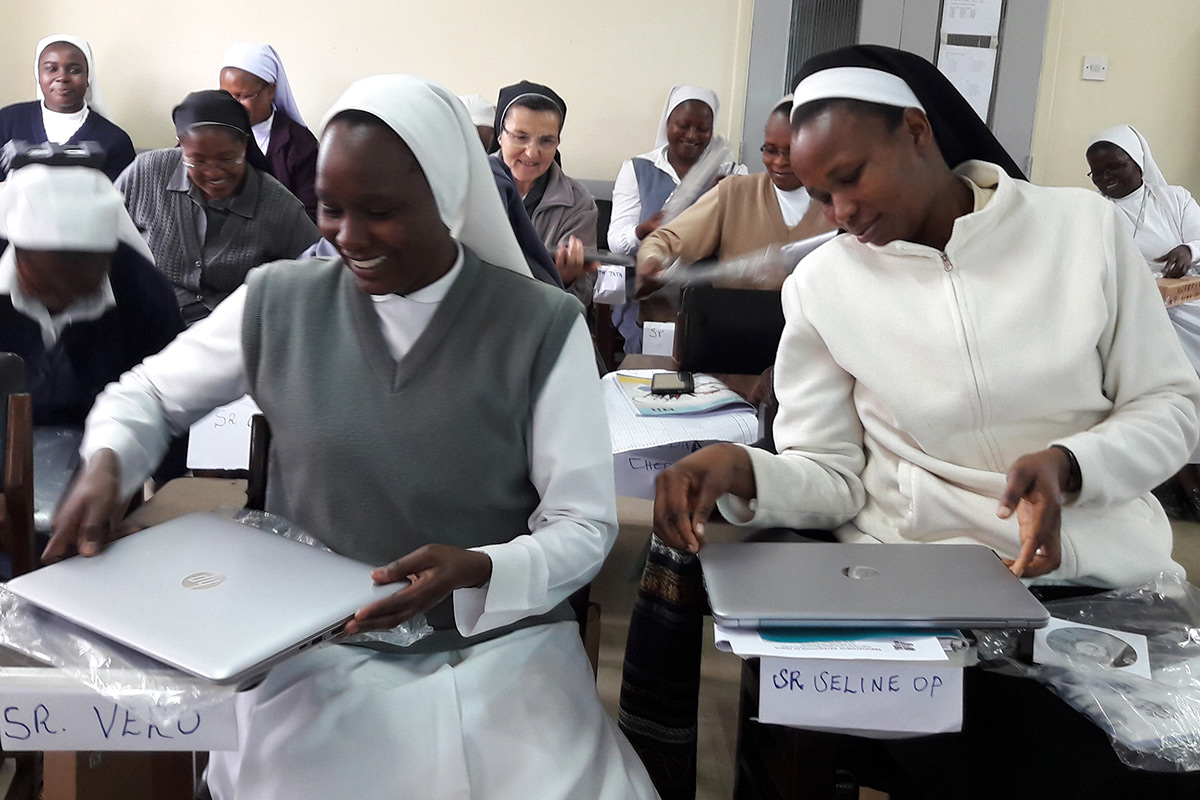 Sr. Veronica and Sr. Seline checking on their new laptops during the SLDI Finance I Workshop in Kenya.