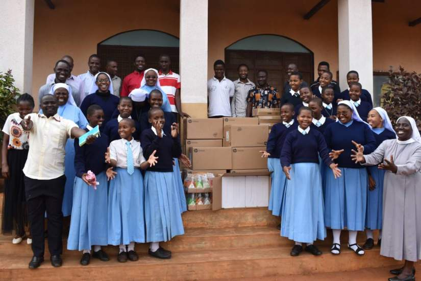 In celebration of their academic success, Bigwa students received the gift of 10 desktop computers from ASEC donors so they can continue to excel in their studies. As you can see, the students are so grateful to our donors!
