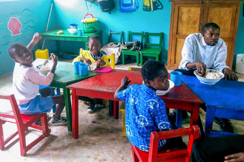 Children at St. Elizabeth Day Center for Children & Young Adults with Disabilities share a meal and welcome ASEC staff (June, 2018).