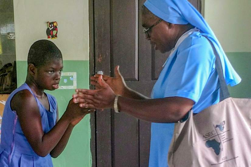 ASEC's Regional Director of West Africa, Sr. Francisca Damoah, SIJ, plays with one of the children at St. Elizabeth's during a staff site visit (June, 2018).