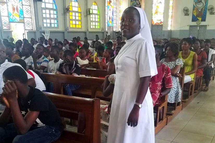 SLDI participant Sr. Vera Ndifoin prepares to give a motivational speech to 100 women and children.