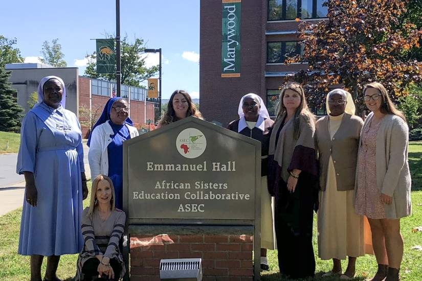 Sr. Margaret Mary Dione Ajebe-Sone, SST, M.Ed. of Cameroon (standing, 2nd from left) visiting with ASEC staff at Marywood University. Sr. Margaret is the fifth Sister scholar accepted for a six month research fellowship with ASEC partner, the Center for Applied Research in the Apostolate (CARA), Georgetown University.