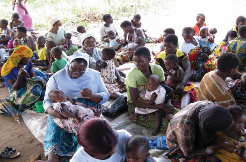 Sr. Hellen Matchado is improving nutrition and food security in Malawi for pregnant women. Here, she's seen feeding a malnourished child and demonstrating positive parenting to new mothers.