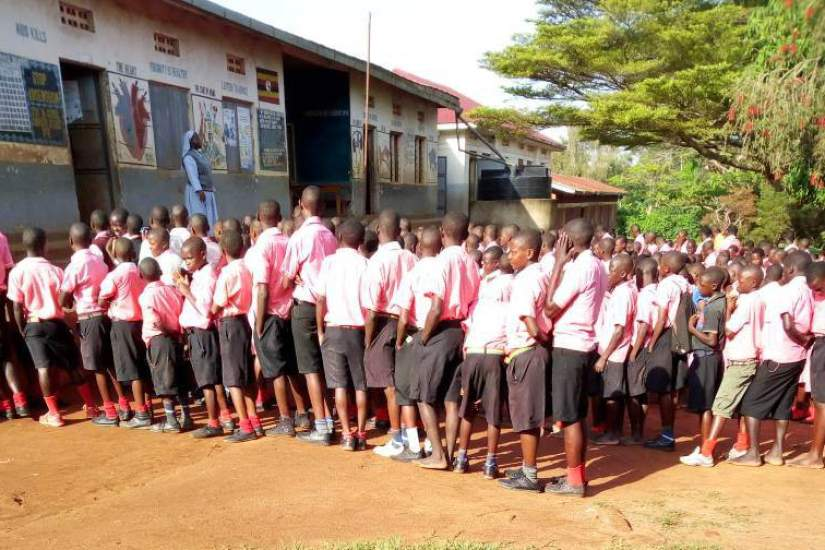 After graduating with a BA in Education through the HESA program, Sr. Betty's congregational superiors appointed her as a Head teacher of St. Matia Mulumba, Kiganda RC Primary. Here she is addressing the pupils at her school.