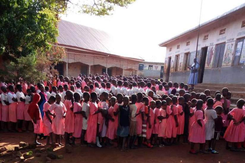 Sr. Betty, Head Teacher at St. Matia Mulumba Kiganda RC Primary, addresses her pupils. St. Matia is a government-aided primary school in Kiyinda-Mityana Diocese, Mubende District in Uganda.