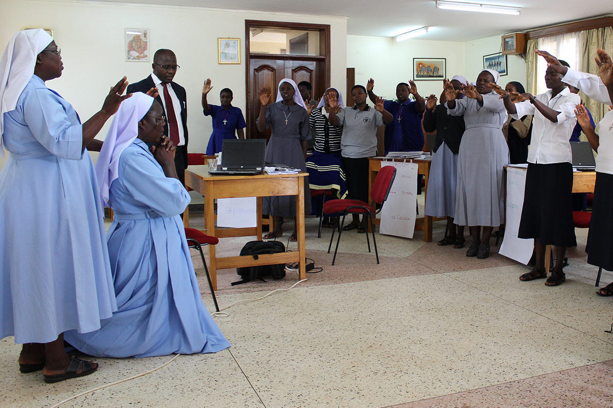 Sr Irene and participants of Finance II pray for ASEC's new Executive Director, Sr. Draru Mary Cecilia, LSMIG.