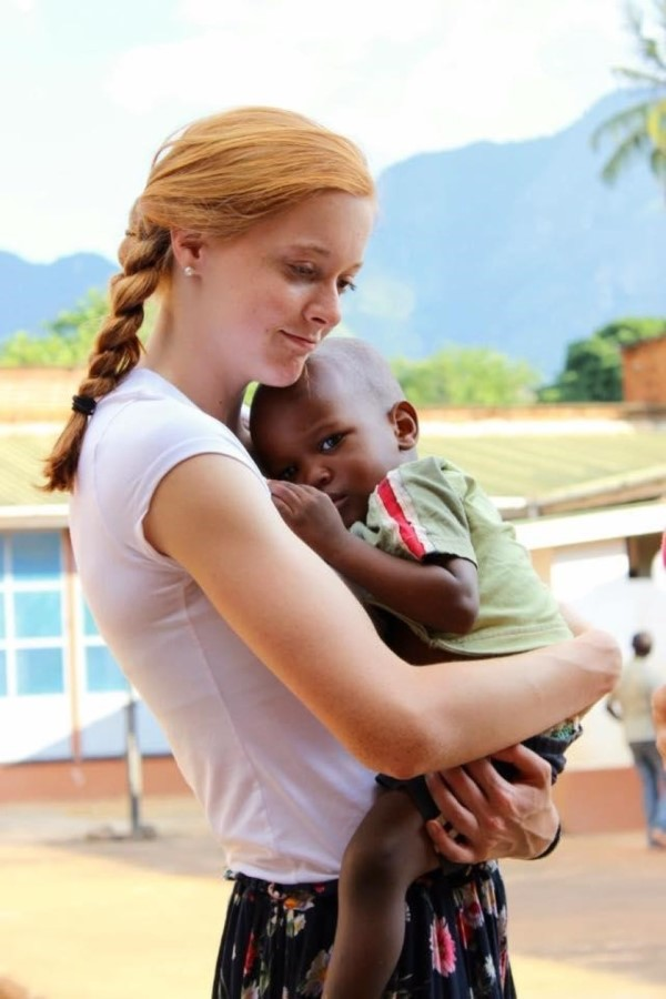 Emily  with an orphaned boy in Tanzania