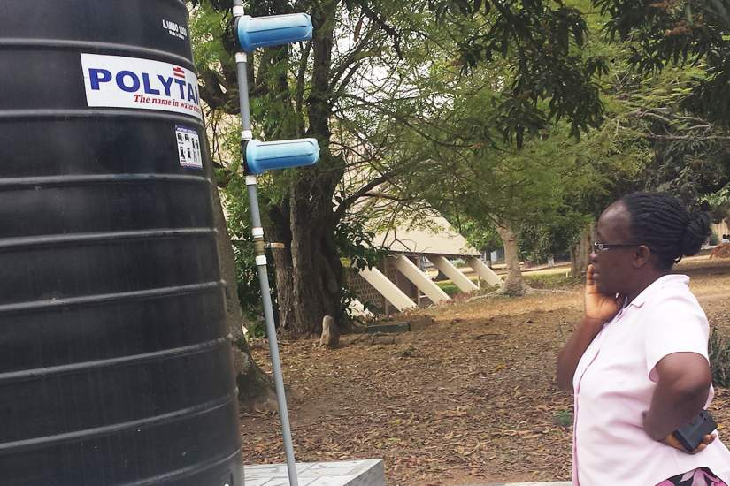 Sr. Mary Lucy inspects the water system that will bring clean water to 13 schools and thousands in her community in Ghana. The project uses water treatment systems to filter and chlorinate the water, making it safe to drink.