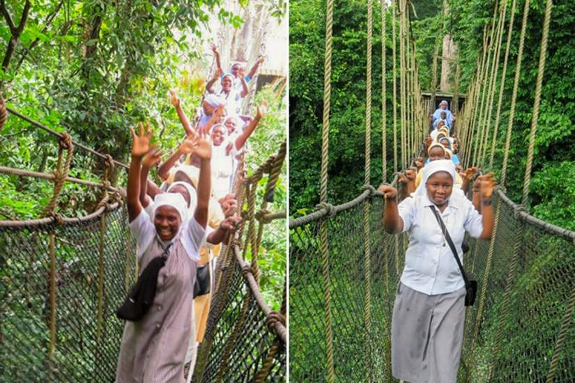 Sisters on the Kakum Canopy Walk in Assin South, Ghana. The canopy walk allows visitors to experience a portion of the jungle usually reserved for climbers and fliers thanks to a trail of precariously hung suspension bridges.