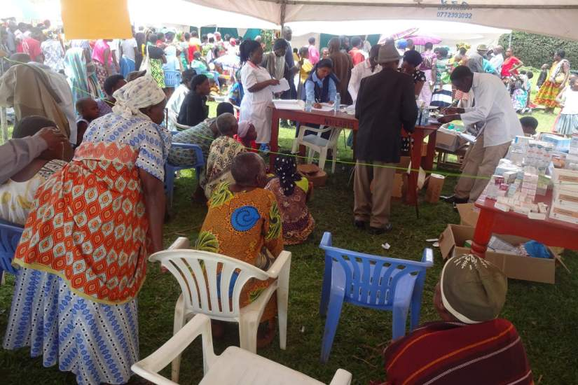Large groups of people gathered for the free medical camp held in the rural village of Nyabwina, Uganda.