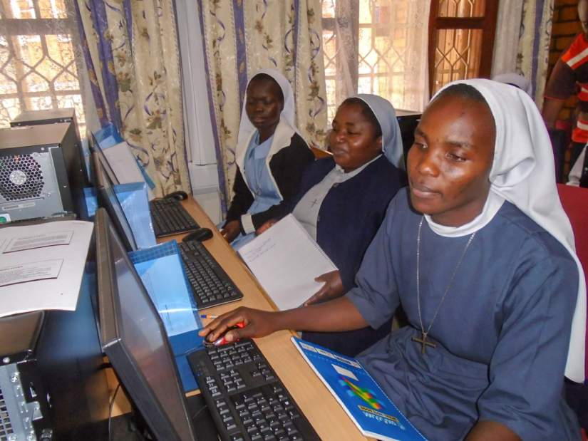 Sr. Faustina (right) learning how to use the computer in SLDI's Basic Technology workshop (May, 2016).