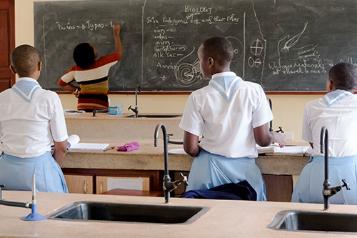 Women religious studying biology at Bigwa Girls Secondary School in Morogoro, Tanzania. A grant in March 2011 funded ASEC to support Bigwa with construction of labs for physics, chemistry, and biology.