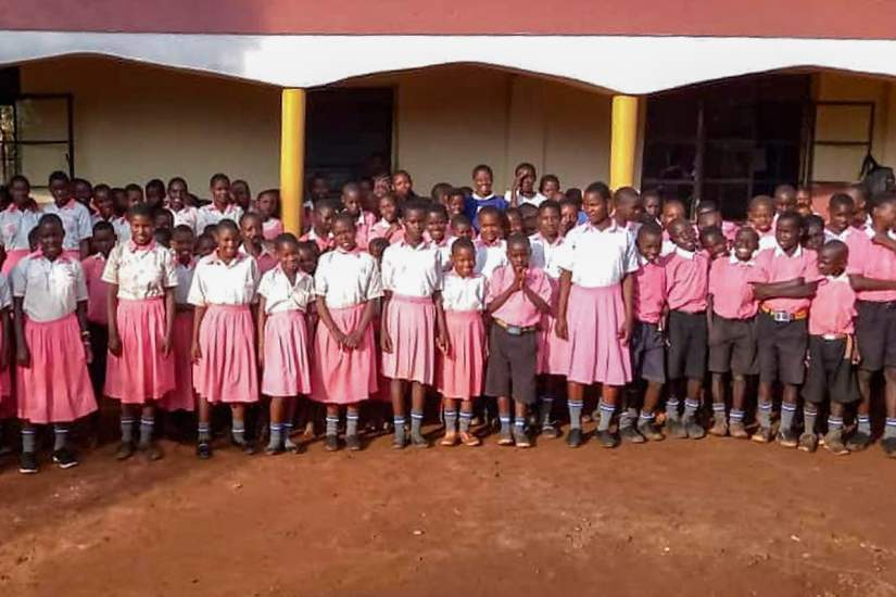 Primary school students in front of the new building at St. Matia, which was made possible by Head Teacher Sr. Betty.