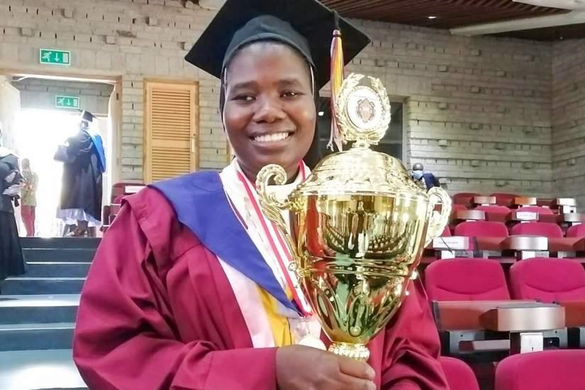 Sr. Irene holding her Valedictorian award at the CUEA graduation ceremony in November, 2020.