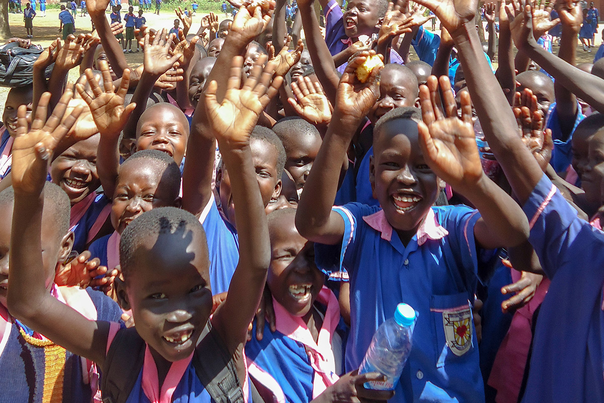 Students of Usratuna Primary School in Juba, South Sudan are overjoyed to receive new school supplies.
