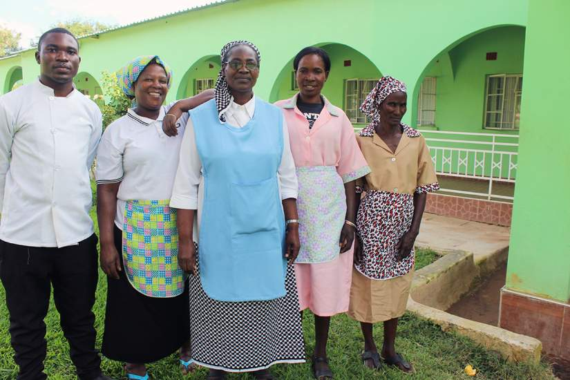 Sr Priscilla Mwanza, center, poses for a photo with the staff at Mt. Zion retreat centre. She's currently an SLDI participant studying Finance.