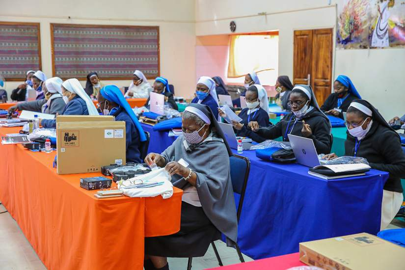 COVID-19 could not spoil this day for SLDI participants in Zambia; sisters eagerly explore their new laptops.