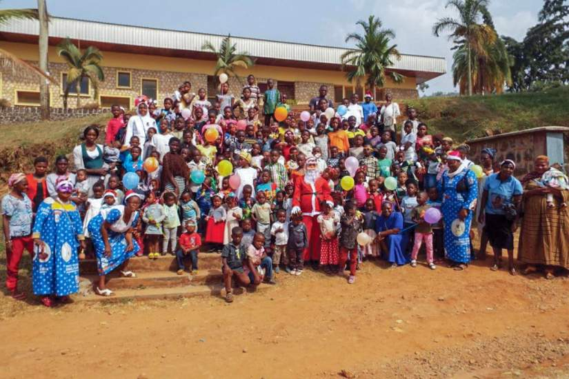Group photo of the Christmas party attendees. The children left the party with smiles on their faces and joy in their hearts.