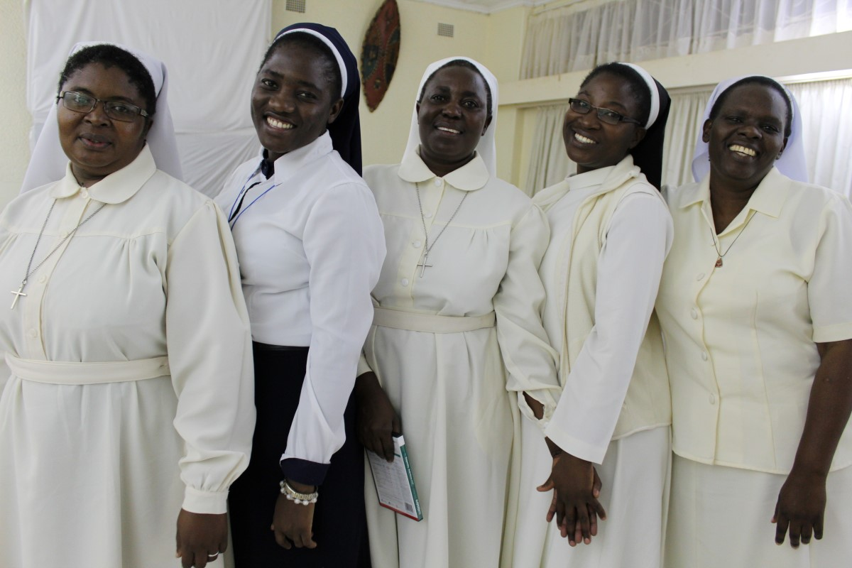 Five Catholic Sister students from Zambia pose for a photo. They are studying for college degrees in the online/onsite hybrid track offered through ASEC's Higher Education for Sisters in Africa (HESA) program.