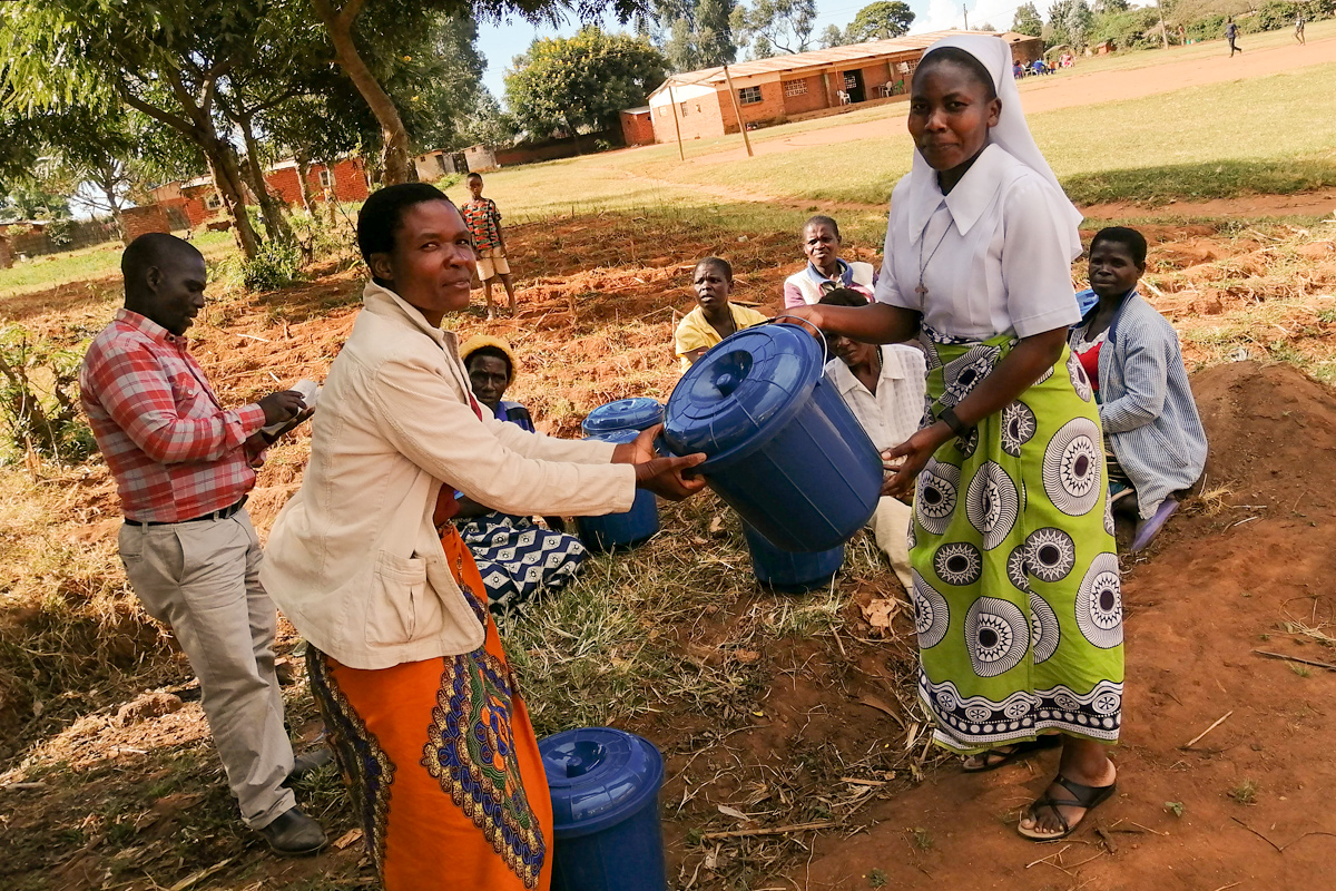 A successful grant proposal by ASEC staff member Sr. Teresa Mulenga, TS, provides members of 5 HIV/AIDS support groups in Malawi with sanitation materials like tap buckets and soap. The members were also taught proper hand-washing techniques to keep them healthy during the COVID-19 pandemic.