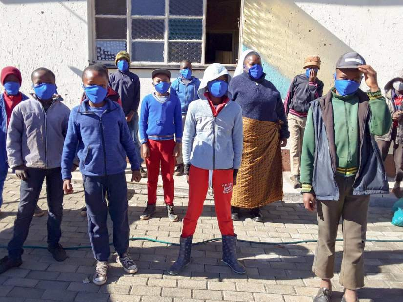 Sr. Theresia Noko stands with boys who are beneficiaries of her educational COVID-19 workshop. The boys also received masks that were sewed by the Sisters of Charity of Ottawa (SCO) in Lesotho.