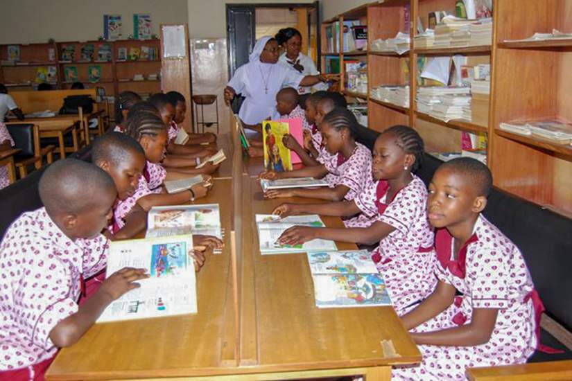 Students of Eucharistic Heart of Jesus Nursery and Primary School reading books in their new library. Funding for the library and books was secured by SLDI alumna Sr. Immaculata Njok, EHJ, who is working to improve literacy and infrastructure in Africa.
