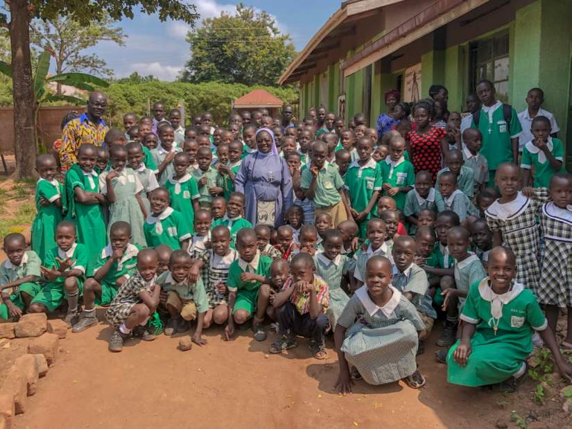 ASEC staff and partners visit to Kikyusa Primary & Secondary schools in Kikyusa, Uganda, run by the Sisters of Mercy of the Holy Cross (MHC).
